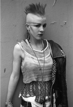 [B/w photo of a person wearing elaborately layered ragged clothes, extravagant makeup, and a mohawk] k-a-t-i-e-:  Kings Road June, 1984 Dere...