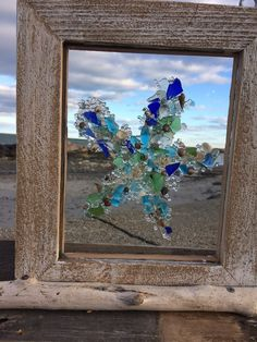 Dancing starfish in all colors of the sea. Found beachglass fused into a recycled glass pane and frame in handcrafted barn board. Perfect for the star fish collector. 12 x 10 SIZE