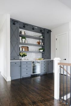 Interior Design Ideas: Grey Shingle Home - Diesel S. - Interior Design Ideas: Grey Shingle Home Grey bar cabinet This home also features an oversized built-in bar with beverage fridge and floating shelves Bar - Built In Bar Cabinet, Built In Buffet, Built In Cabinets, Ikea Bar Cabinet, Modern Bar Cabinet, Home Bar Cabinet, Cabinet Fronts, Home Bar Designs, Home Design