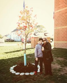 Mrs. Labak  Abdulrahmans mother and his brother next to the memorial tree planted in his memory and in the memory of all students who have left at a young age this life ... and tree surrounded by a memorial mosaic made by Abdulrahman's peers and friends at Universal Academy. More pictures and videos are being prepared by HES Family Engagement department to be posted next week. #hesacademies