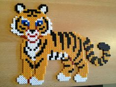 Tiger hama beads by - Perler patterns Hama Beads Design, Diy Perler Beads, Perler Bead Art, Pearler Bead Patterns, Perler Patterns, Art Perle, Motifs Perler, Beaded Banners, Peler Beads