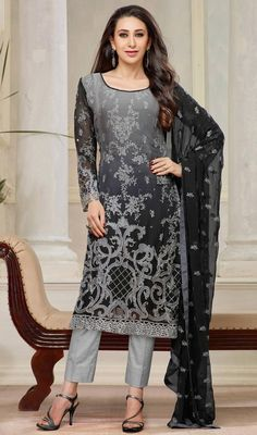 Stylize yourself like Karisma Kapoor, with this black and gray color georgette embroidered salwar suit. The lace, patch, resham and stones work seems to be chic and aspiration for any occasion. #CharmingKarishmaKapoorGeorgetteDressCollection