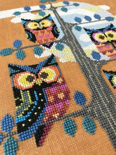 Whooos that perched in a spooky old tree? Its Satsuma Streets family of funky modern owls, ready for Halloween or any time of year! This design looks great stitched on orange fabric for the Halloween season, but would look stylish stitched on brown or natural linen too. This digital PDF