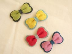 Mini felt bows-easy to make.  Perfect to stick on with Girlie Glue!  No clips bands or even Hair necessary!  Stick onto the hair or skin with GIrlie Glue!  It is all natural and lasts all day.  Washes off easily with water too!  Makes an Awesome baby gift!  girlieglue.com