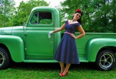 Pinup girl with green classic truck