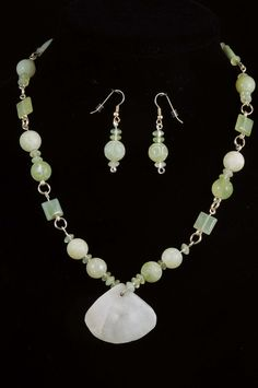 A strong inner serenity and overall sense of peace will embrace the lucky owner of this beautiful necklace and earring set. Milky White Quartz fan (1 1/4inches x 1 ½ inches) is hand shaped and polished. A soothing collection of Jade includes New Jade in 10 mm etched rounds, puffy Jade pillows and rondelles. Silver plate wire and connectors bring it all together for a stunning piece of art. 19 inch to 20 inch adjustable. Continue reading