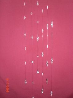 DIY Hanging Crystals - Use colorful crystals and beads to hang shower curtain, decorative way to get it to hang lower with tall ceilings :)