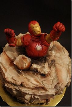 The Ultimate Iron Man Cake. WOW! I would probably use an action figure toy instead of sculpting Iron man.  I love it! - could do a HULK SMASH cake similar to this too