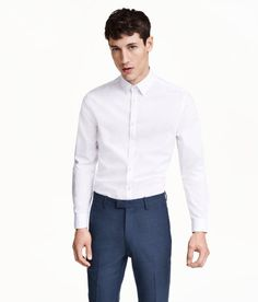 Check this out! Long-sleeved shirt with a turn-down collar and easy-iron finish. Shaping darts at back for a tailored silhouette. Slim fit. - Visit hm.com to see more.