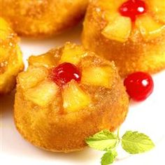 Pineapple Upside Down Cupcakes   Ingredients:  cooking spray  1/2 cupbutter, melted  1 1/2 cupsbrown sugar  24maraschino cherries  1 (20 ounce) cancrushed pineapple  1 (18.25 ounce) packagepineapple cake mix (such as Duncan Hines® Pineapple Supreme)   3eggs  1 1/3 cupspineapple juice  1/3 cupvegetable oil  1 tablespoonconfectioners' sugar for dusting, or as needed