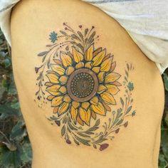 Large+sunflower+on+ribcage+by+Dino+Nemec