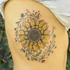 Large sunflower on ribcage by Dino Nemec