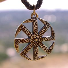 "KOLOVRAT - Pendant made of bronze. 100 % HANDMADE! Top grade. Slavic ancient spiritual religious symbol - Kolovrat / solstice Kolovrat or solstice - one of the oldest ancient characters , symbolizing the sun. Bronze protect pendant, a great souvenir and gift. Pendant "" Kolovrat "" size: 1.44"" (3.6cm) x 0.16"" (0.4cm) x 1.20"" (3.0 см)"