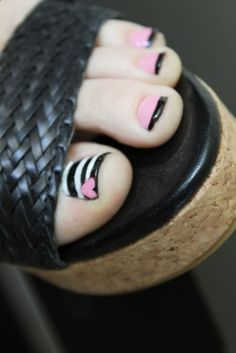 Cute simple toenail design. Black and white stripes on big toe with pink heart, rest of toes pink with black tip - Be Beautiful