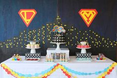 Dessert table at a Superhero Themed Birthday Party via Kara's Party Ideas KarasPartyIdeas.com Cake, decor, favors, printables, tutorials, and more! #supehero #superheroparty #supeheropartyideas