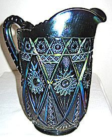 Here is a gorgeous vintage Carnival Glass pitcher in the Diamond Lace pattern made by Imperial. It stands 8.75 inches tall and the glass color is a deep amethyst with beautiful iridescence. This pitch