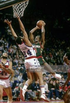 BALTIMORE, MD - CIRCA 1980's: Sidney Moncrief #4 of the Milwaukee Bucks in action shooting over Jeff Malone #24 of the Washington Bullets during a early circa 1980's NBA basketball game at the Baltimore Coliseum in Baltimore, Maryland. Moncrief played for the Bucks from 1979-89.