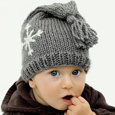 Knitted hat on a baby with blue eyes? Winning.