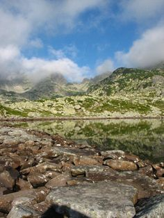 cliffs reflecting the largest glacial lake of Romania, lake Bucura, in Retezat National Park (photo by Diana Condrea)