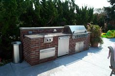 Another nice brick outdoor kitchen area, without a sink.