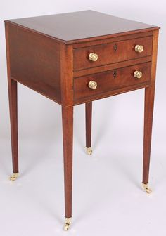 George III period mahogany occasional end-table; the square top fitted with two drawers with original brass knob-handles and inlaid ebony lozenge escutcheons, on square tapered legs with brass box castors. Polished all round. Circa 1800.