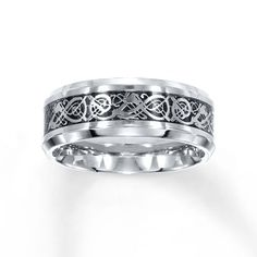 An intricate scroll design is the highlight of this distinctive 8mm women's wedding band, crafted of stainless steel.