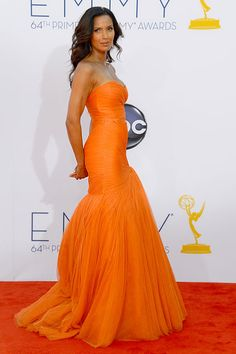 Padma Lakshmi definitely made a dramatic entrance in a bright orange Monique Lhuillier dress.