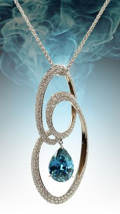 Blue zircon, diamond and platinum pendant designed by award-winning jewelry artist Judy Evans.