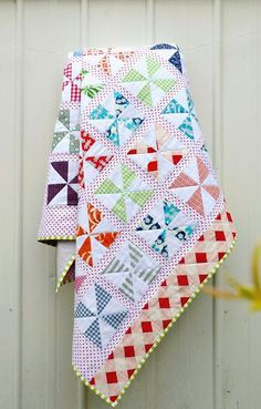 Red Pepper Quilts: Pinwheels on Parade Quilt and New Quilt Pattern- with a fun back ! Love it !