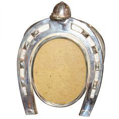 Vintage Hermes horseshoe-shaped picture frame.