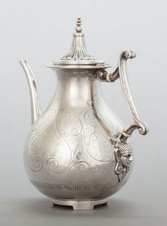 English sterling silver coffee pot in an Egyptian Revival style, with a medallion mask at the base of the handle - by George Angell, London, c1860 (Heritage Auctions)
