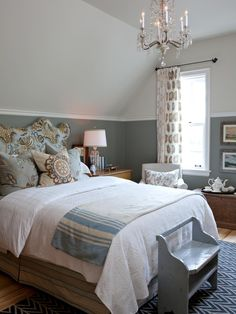 A foil to the vibrant north bedroom, the west bedroom feels calm, classic and country — but not hokey. A custom headboard upholstered in a floral-print fabric makes a strong statement, while a refurbished chandelier adds a bit of glitz to the space.