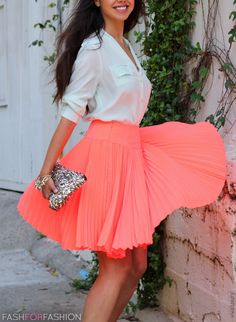 White blouse girl + bright pleats + sparkle clutch