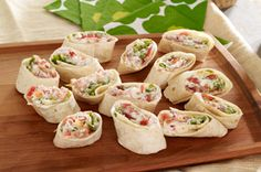 BLT Rollers recipe-MIX cream cheese and mayo in medium bowl. Add bacon and tomatoes; mix well.     SPREAD onto tortillas; top with lettuce. Roll up tightly.     CUT each into 7 diagonal slices.
