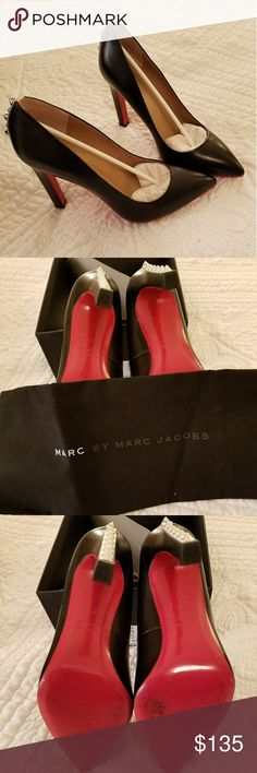 MARC JACOBS RED SOLED STILETTO HEELS GORGEOUS BLACK LEATHER SUPER SEXY, RED SOLE WITH  SILVER STUDDED STILETTO  HEELS  SIZE 6 1/2. DESIGNER...MARC BY MARC JACOBS. A MUST HAVE FOR EVERY SEXY LADY!💕 LIKE NEW... MARC JACOBS Shoes Heels