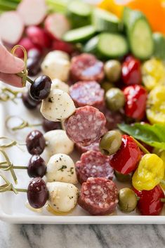 50 of the Best Appetizers for the Holidays - A Dash of Sanity These antipasto kabobs are an assortment of italian meats, cheeses, olives and vegetables threaded Skewer Appetizers, Elegant Appetizers, Italian Appetizers, Holiday Appetizers, Appetizer Recipes, Cold Appetizers, Party Appetizers, Salami Appetizer, Holiday Recipes