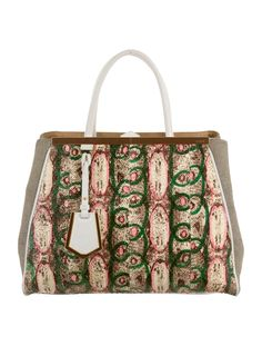 From the Fall 2014 Collection. Pink, green and multicolor python Fendi 2Jours tote with gold-tone hardware, white leather trim, detachable shoulder strap, dual rolled top handles, black and white woven panels at sides, beige canvas interior lining, three interior compartments; one with zip closure dual pockets at interior walls and snap closure at top. Includes dust bag. Shop Fendi consignment handbags at The RealReal.