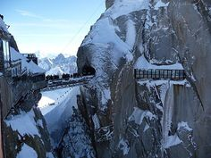 Aiguille du Midi, France.   The cable car ride up & standing on this deck would freak me out.... but skiing down (with a guide) would be worth it!