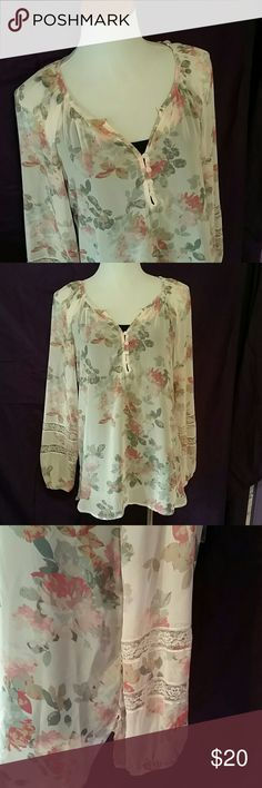 "NEW LISTING--Sheer Floral Top This stunning sheer floral top is NEW WITH TAGS! It has classy lace detailing in the sleeves, elastic wrists, and button-up v-neck front. Soft pinks, blues and greens make this a perfect top for spring, which is just around the corner! PERFECT condition (no snags, wrips, holes or stains). Factory slits on the side.   27.5"" sleeves (from the neck) 28"" long in back 23"" in front (from bottom of the neck) LC Lauren Conrad Tops Blouses"