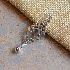 Celtic Knot Pendant with Ball Drop, Silver Celtic Knot, Hand Cast Sterling Silver, Silver Drop Pendant, 35x13mm, 5mm Closed Jump Ring Bail by WanderlustWorldArts on Etsy