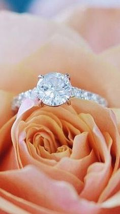 This romantic diamond engagement ring is dazzling.