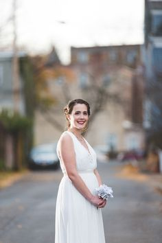 Simple elegant wedding dress idea - V-neck chiffon gown + hair styled in a braided updo {Jay Zhang Photography}
