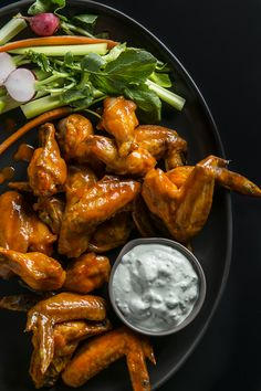 Learn to make buffalo wings that cause no mess! Sidestep messy frying and bake your Buffalo wings (see the recipe), then use an electric skillet to keep them warm all the way to the fourth quarter.