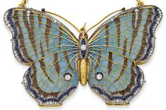 An early 20th century enamel, sapphire, ruby, diamond, silver and gold butterfly evening bag ~ 1900