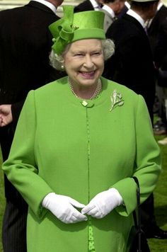 Her majesty looks smashing in brilliant lime green coat & hat.  You can see the slightly light green dress with tiny polka dots underneath.  The straw hat is dyed the exact same color as her coat.  3 strand pearl necklace, rose brooch & white gloves complete the look.