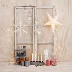 Star on ladder or window behind manger  square galvanized filled with natural materials