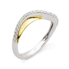 Anniversary Collection  This lovely 18K white and yellow band is comprised of .20ctw round white Diamonds.  MR1891