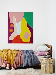 Amazing kids room with cosy layers of Kip & Co bedding and a bright Leah Bartholomew original artwork