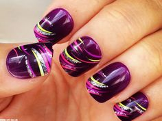Purple base with light purple, green, silver glitter, and pink swirls/stripes