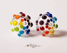 Lampwork beads by Olia Oleksiichuk on Facebook.